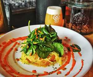 Our Vegetarian dish: Spaghetti Squash with Sauteed Spinch and Roasted Red Pepper Sauce